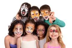 Niños con la cara-pintura imagenes de archivo