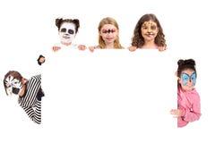 Niños con la cara-pintura animal fotos de archivo