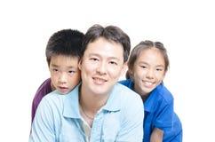 Niños con la sonrisa del padre Fotografía de archivo libre de regalías