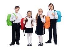 Niños con las mochilas - de nuevo a tema de la escuela Fotografía de archivo libre de regalías