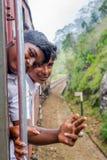 Niños de la escuela que viajan en tren Imagenes de archivo