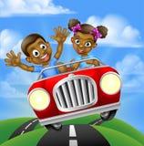 Niños de la historieta que conducen el coche Imagen de archivo