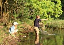 Niños de la pesca fotografía de archivo libre de regalías