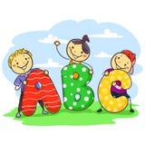 Niños del palillo que detienen al espectador de pie de ABC Foto de archivo libre de regalías