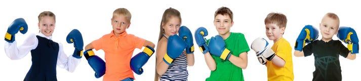 Niños divertidos en guantes de boxeo Fotografía de archivo libre de regalías