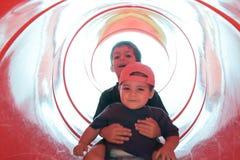Niños en diapositiva Imagenes de archivo