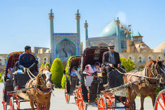 Niños en el carro en el imán Squares, Isfahán imagen de archivo