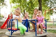 Niños en el carrusel Fotografía de archivo libre de regalías