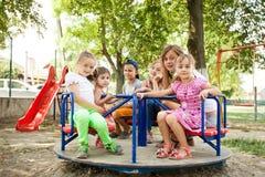 Niños en el carrusel Imagen de archivo libre de regalías