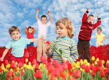 Niños en el collage del campo de los tulipanes Fotografía de archivo