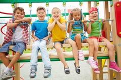 Niños en el oscilación Fotografía de archivo libre de regalías