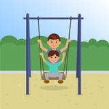 Niños en el oscilación en el parque Imagenes de archivo