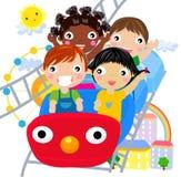 Niños en el parque de atracciones Imágenes de archivo libres de regalías