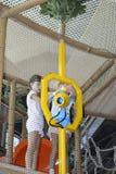 Niños en el parque de atracciones Fotografía de archivo libre de regalías