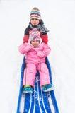 Niños en el trineo de la sacudida Imágenes de archivo libres de regalías