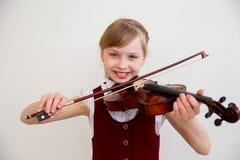 Niños en escuela musical Fotografía de archivo