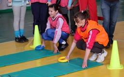 Niños en la competición del atletismo de IAAF Kidâs Imágenes de archivo libres de regalías