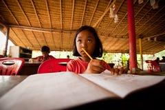 Niños en la lección en la escuela Fotografía de archivo libre de regalías
