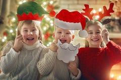 Niños en la Navidad Foto de archivo libre de regalías