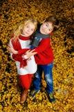 Niños en otoño Imágenes de archivo libres de regalías
