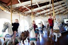 Niños en un carrusel Imagen de archivo libre de regalías