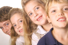 Niños en una línea Imagenes de archivo