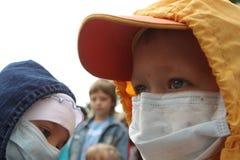 Niños en vendajes Imagen de archivo libre de regalías