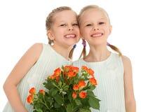 Niños felices con un ramo de flores Fotografía de archivo libre de regalías