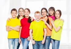 Niños felices del grupo en escuela Fotografía de archivo