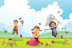 Niños felices en la estación de resorte Imagen de archivo libre de regalías