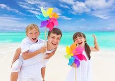 Niños felices en la playa Foto de archivo libre de regalías