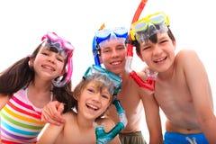 Niños felices en tubos respiradores Fotografía de archivo