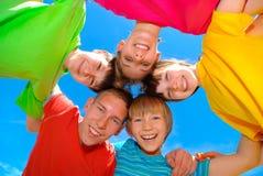 Niños felices en un círculo Imagen de archivo libre de regalías