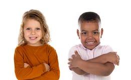 Niños felices que miran la cámara fotos de archivo libres de regalías
