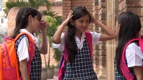 Niños hispánicos sorprendidos de la escuela que llevan los uniformes escolares Fotos de archivo libres de regalías