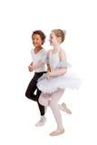 Niños interraciales que bailan junto Imágenes de archivo libres de regalías
