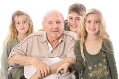 Niños jovenes con el hombre del eldery Imágenes de archivo libres de regalías