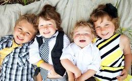 Niños jovenes que colocan Fotografía de archivo