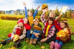 Niños muy felices en el césped Fotografía de archivo