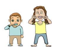 Niños que cepillan y que limpian los dientes Imagen de archivo libre de regalías
