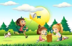 Niños que cogen la mariposa en el jardín libre illustration