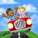 Niños que conducen el coche Foto de archivo