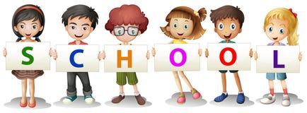 Niños que forman las letras de la escuela Imagen de archivo libre de regalías