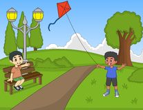 Niños que juegan cometas en el parque ilustración del vector