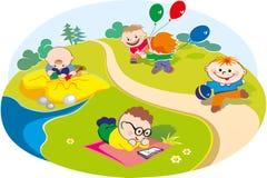 Niños que juegan en el prado Imagen de archivo libre de regalías