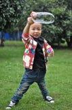 Niños que juegan la burbuja Fotografía de archivo