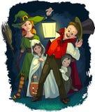 Niños que juegan truco o la invitación en el costu de Halloween Imagenes de archivo