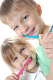 Niños que limpian los dientes Foto de archivo libre de regalías
