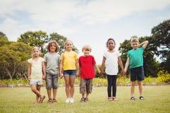 Niños que llevan a cabo las manos Imagen de archivo libre de regalías