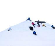 Niños que suben nieve Imagen de archivo libre de regalías